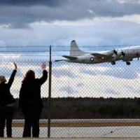 Women nod after plane in Naval Air Station Brunswick