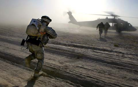 Soldiers running to helicopter at Camp Dwyer