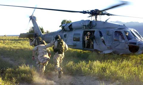 Soldiers jumps into helicopter at NAS Fallon