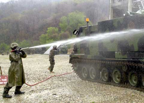 Soldiers washing tank at Camp Hovey in South Korea