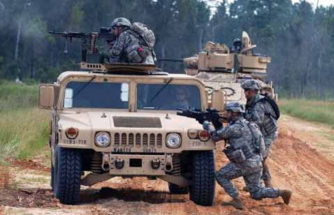 Fort Stewart Base - Soldiers hiding behind Hummer