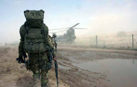 Soldiers fully equipped goes to helicopter
