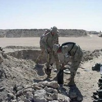 Soldiers filling sandbags at Camp Doha